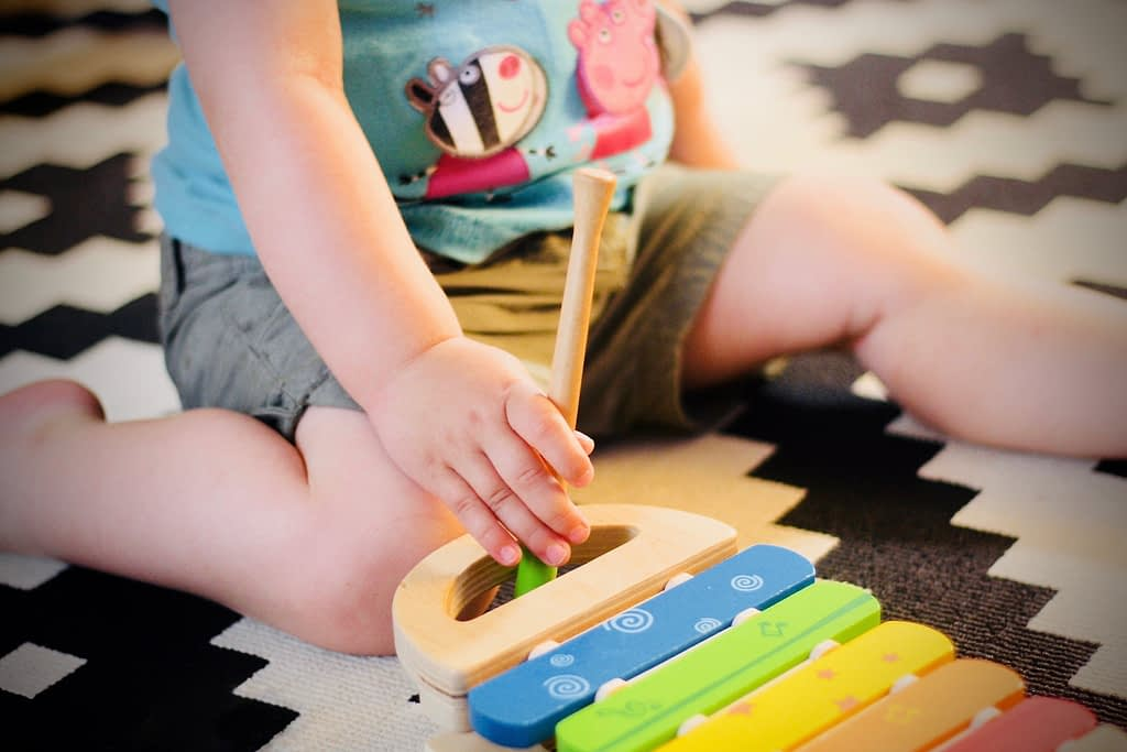 Toddler playing with musical toy